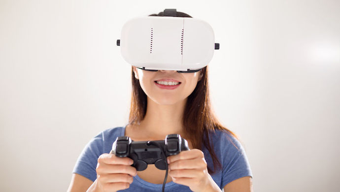 57370855 - woman play video game wearing virtual reality headset
